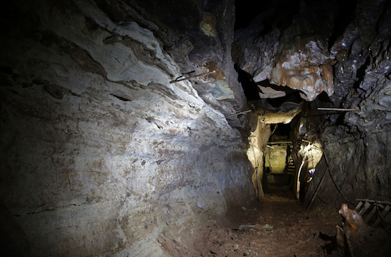 This photo made Thursday, April 14, 2016, shows a cave discovered in 1993 by Bass Pro Shops founder Johnny Morris in Ridgedale, Mo. Morris believes the cave could be part of a larger unknown system after water from a sinkhole on his golf course about a half-mile away began flowing out the entrance. (AP Photo/Jeff Roberson)