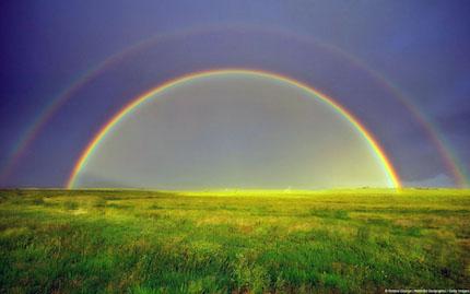 Double rainbow in a meadow, Silt, Colorado, U.S.